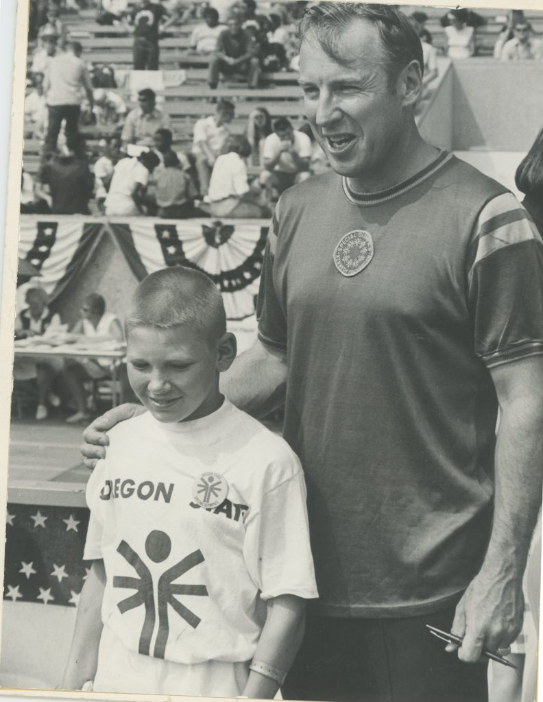 Jim Lovell and a Special Olympics athlete
